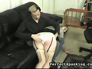 A -cup cutie, spanked and paddled by man and woman.